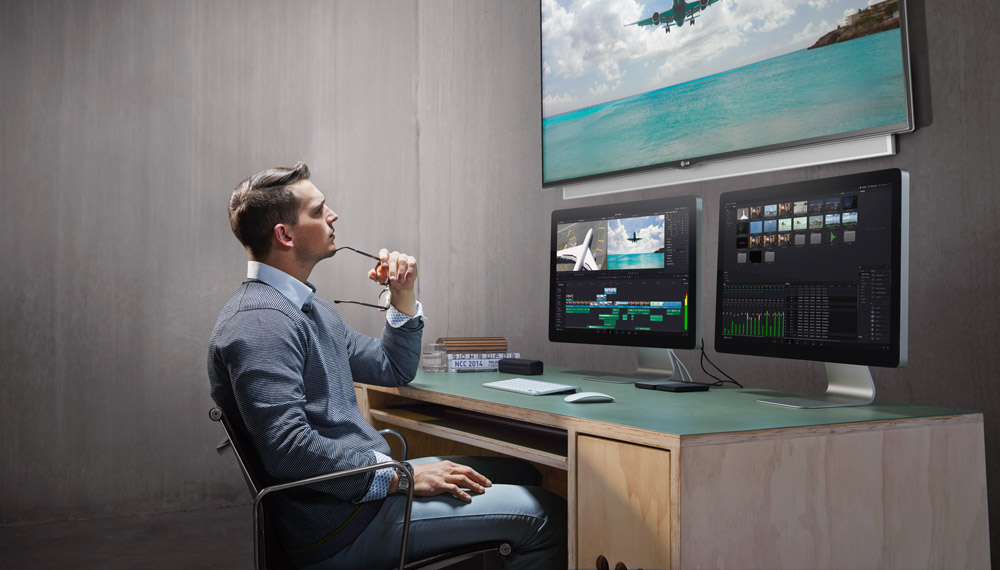 Man reviewing footage on DaVinci Resolve hardware and software